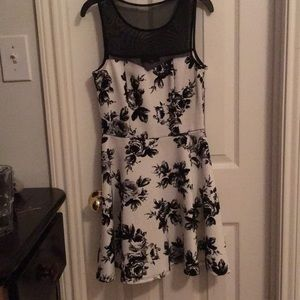 This is a cute dress, worn good with black shoes